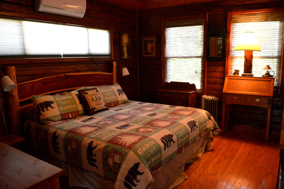 Rustic Orlando Cabin Rental King Size Bed in Master Bedroom